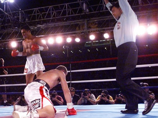 Oscar De La Hoya moves to a neutral corner after knocking down his French opponent Patrick Charpentier in the third round.