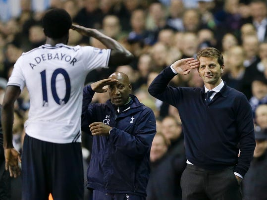 FILE - This is a  Monday, April 7, 2014  file photo of Tottenham's manager Tim Sherwood, right, as he salutes striker  Emmanuel Adebayor, left, after he scored a goal during the English Premier League soccer match between Tottenham Hotspur and Sunderland at White Hart Lane stadium in London. Tottenham  fired manager Tim Sherwood Tuesday May 13, 2014 less than five months into his first coaching job. The Premier League club says it has exercised the end-of-season break clause in Sherwood's 18-month contract. The inexperienced Englishman was promoted within the north London club in December after Andre Villas-Boas was fired. (AP Photo/Kirsty Wigglesworth. File)