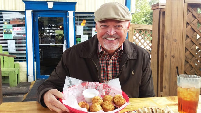 Ken Winter about ready to enjoy some Hotty Toddy balls made with mashed potatoes and other good stuff at Volta in Oxford, Miss.