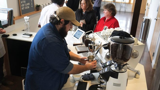 Barista Ryan Riddell prepares an order at Honeybee Coffee Company on Tuesday, Jan. 10, 2017, in South Knoxville.