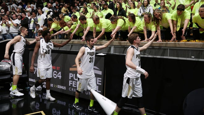 From left to right Purdue Boilermakers center Isaac Haas (44), Caleb Swanigan (50), guards Dakota Mathias (31) and Ryan Cline (14) high five the fans after the game against the Ohio State Buckeyes at Mackey Arena. Purdue defeats Ohio State 75-64.
