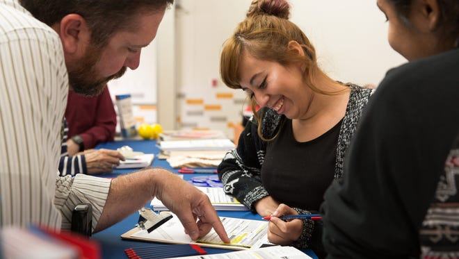 Doña Ana Deputy County Clerk Scott Krahling, left, helps Centennial High School student Virginia Gonzalez fill out a voter registration form on Tuesday, Sept. 27, 2016, during a National Voter Registration Day event. The County Clerk's Office organized voter-registration drives for students, teachers and parents at seven area high schools.