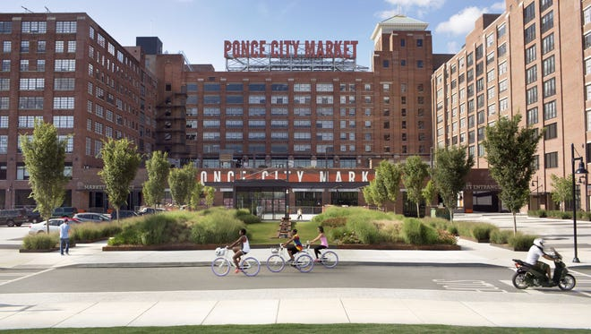 Ponce City Market officially opened in 2015. As you approach the market, you'll notice its signature red block letters. Though they may look small from the ground, each letter is 18 feet tall.