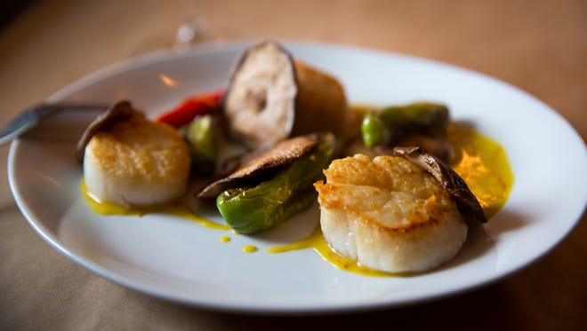 Scallops made by Anchor chef Steven Shockley. Anchor, in Over-the-Rhine, is celebrating their 5th anniversary. The dish is served with shiitake, shishito, saffron almond cream and almond.