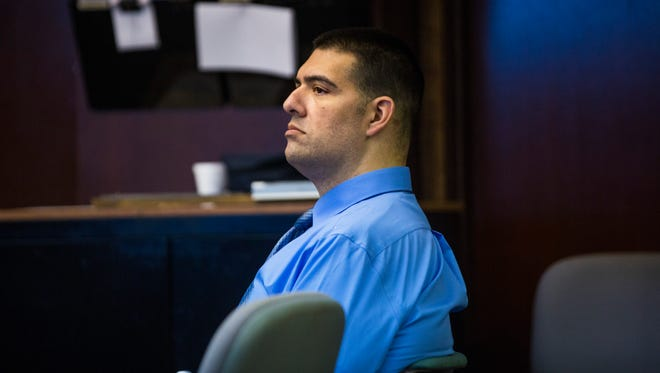 Ricardo Vazquez Jr., a former Naples police officer accused of molesting two girls, listens to witness testimony during day two of his trial at the Collier County Courthouse in Naples on Tuesday, Jan. 9, 2018.