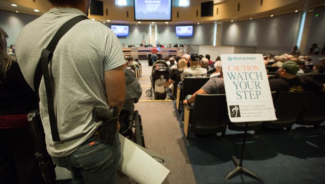 Gun rights activists, many armed with weapons entered the Las Cruces City Council Chambers after holding a protest outside of city hall on Monday March 19, 2018. The protest was against a proposed statement of support for restrictions on the sale or possession of semi-automatic weapons. The council tabled the resolution on a vote of 6-1.