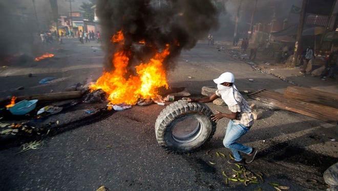 Demonstrators protest over the cost of fuel in Port-au-Prince, Haiti, Friday, July 6, 2018. Major protests erupted Friday in Haiti as the government announced a sharp increase in gasoline prices, with demonstrators using burning tires and barricades to block major streets across the capital and in the northern city of Cap-Haitien.