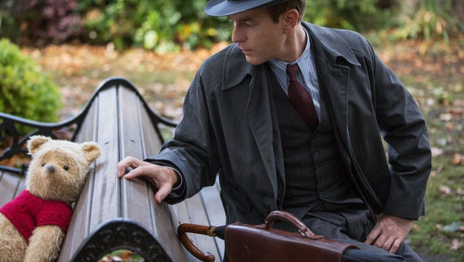 "Christopher Robin (Ewan McGregor, right) encounters his longtime friend Winnie the Pooh in ""Christopher Robin."""