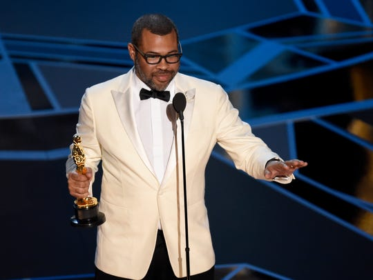 Jordan Peele accepts the award for best original screenplay