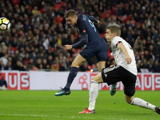 England's Jamie Vardy, left heads the ball towards goal during the international friendly soccer match between England and Germany at Wembley stadium in London, Friday, Nov. 10, 2017. (AP Photo/Matt Dunham)