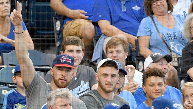 Kansas City Chiefs tight end Travis Kelce (left) and quarterback Patrick Mahomes (right) enjoy the game between the Kansas City Royals and Cleveland Indians at Kauffman Stadium on June 2.