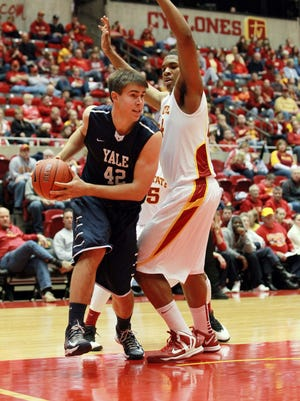 Iowa State Cyclones forward Percy Gibson (34) defends Yale Bulldogs forward Matt Townsend (42) in the first half at Hilton Coliseum.