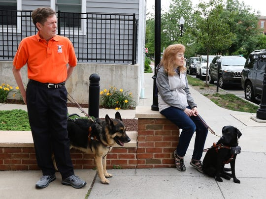 Jim and Ginger Kutsch wait for people to arrive for the The Seeing Eye Walking Tour in Morristown on June 23, 2018.
