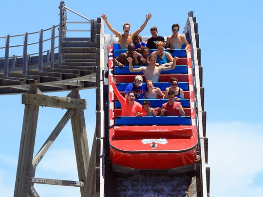 Patrons raise their hands as they prepare for a splash at the Padre Plunge on Friday, July 21, 2017, at Schlitterbahn Corpus Christi.