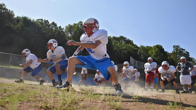 USA players complete a conditioning drill during practice Aug. 11 in Swanville.