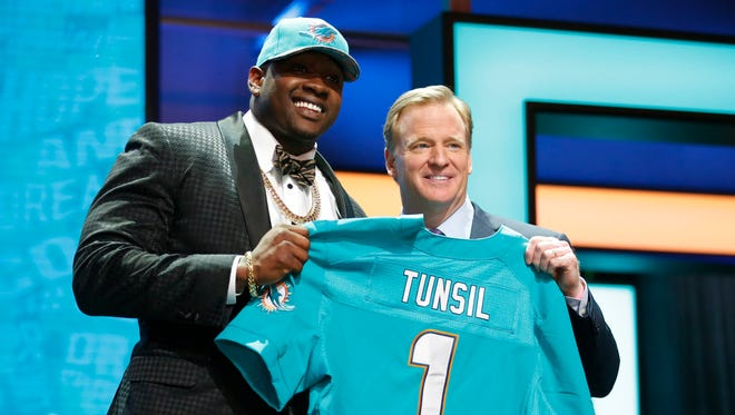 Laremy Tunsil (Mississippi) with NFL Commissioner Roger Goodell after being selected by the Miami Dolphins as the number thirteen overall pick in the first round of the 2016 NFL Draft at Auditorium Theatre.