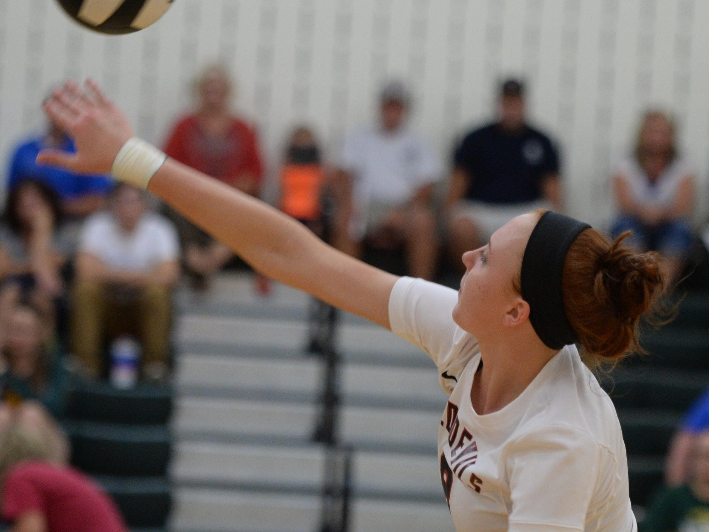 Richmond's Megan Crass hits the ball Tuesday during a volleyball match against Northeastern in Fountain City.