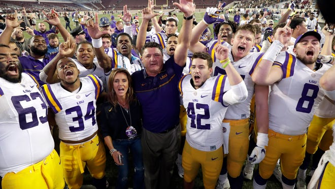 LSU coach Ed Orgeron celebrates with players after an NCAA college football game against Texas A&M Thursday, Nov. 24, 2016, in College Station, Texas. LSU won 54-39.