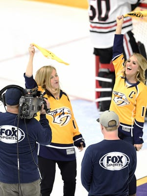 Mayor Megan Barry and country music star Carrie Underwood, wife of Predators captain Mike Fisher, cheer the team April 17, 2017, before the start of Game 3 in the first-round NHL playoff series at Bridgestone Arena.