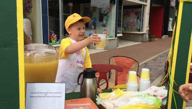 Andy Purcell serves lemonade to a customer during Lemonade Day in 2015. He was planning a donation to the Richmond Police Department's K-9 program.