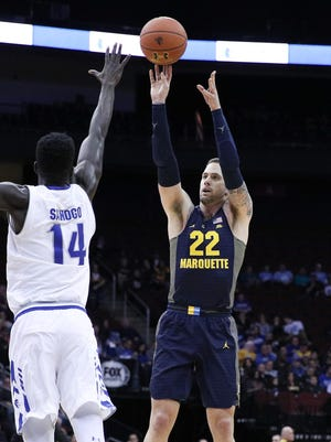 Marquette Golden Eagles guard Katin Reinhardt (22) shoots the ball as Seton Hall Pirates forward Ismael Sanogo (14) defends during the first half at Prudential Center.