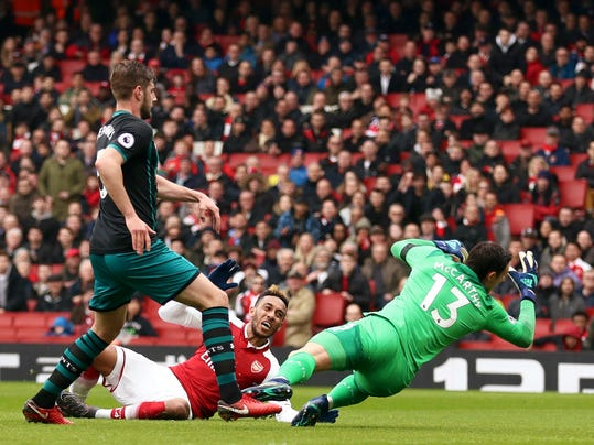 Arsenal's Pierre-Emerick Aubameyang, centre, scores his side's first goal of the game, during the English Premier League soccer match between Arsenal and Southampton at the Emirates Stadium, in London, Sunday April 8, 2018. (Tim Goode/PA via AP)