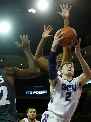 Grand Canyon University's Joshua Braun (2) drives to the basket between Hampton defenders at GCU Arena on Nov. 30, 2015, in Phoenix, Ariz.