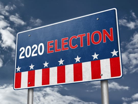 Sign with stars and stripes reading 2020 election