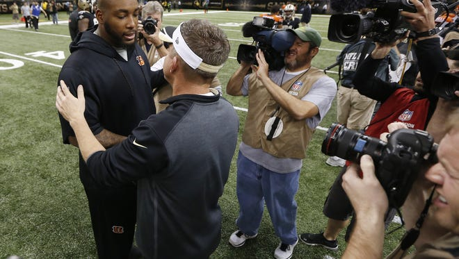The Cincinnati Bengals defensive tackle Devon Still (75) gets together with New Orleans Saints head coach Sean Payton after the game at the Superdome in New Orleans.