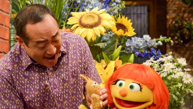 """This image released by Sesame Workshop shows Julia, a new autistic muppet character debuting on the 47th Season of """"Sesame Street,"""" on April 10 on both PBS and HBO."""