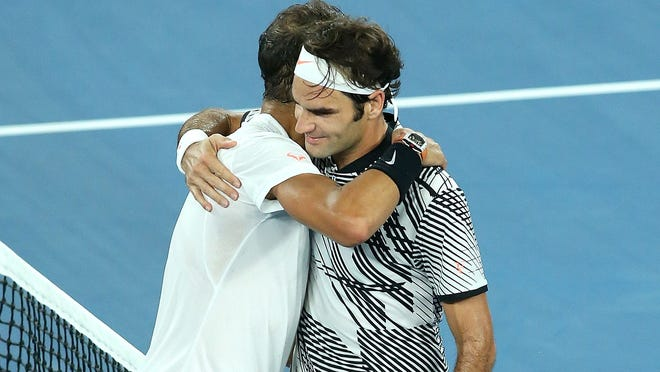 MELBOURNE, AUSTRALIA - JANUARY 29:  Roger Federer  of Switzerland is congratulated by Rafael Nadal  of Spain after  winning  the Men's Final match  on day 14 of the 2017 Australian Open at Melbourne Park on January 29, 2017 in Melbourne, Australia.  (Photo by Pat Scala/Getty Images) ORG XMIT: 671819523 ORIG FILE ID: 632994400
