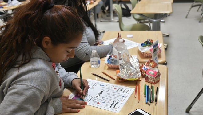 Kaylee Lara, 17, colors during Lindsay High School's My Voice club meeting on Tuesday, April 2.