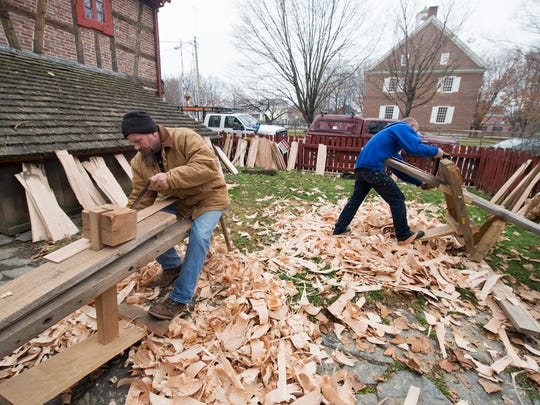 Rich Kratzer Jr., left, and Mike Valent, of The Country Homestead, of Kreamer, use draw knives to create shingles.