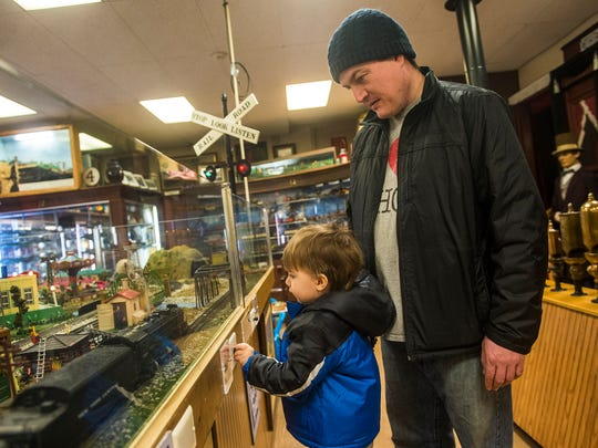 Chris St. John and his son, Elijah St. John, 2, both of Street, Md, watch a model train pass at the Lincoln Train Museum on Steinwehr Avenue in Gettysburg on Feb. 14, 2016.
