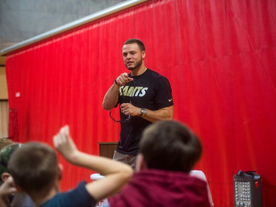 Saints player Erik Harris takes a question from the audience on April 6, 2016 at the Hanover Area YMCA.