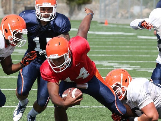 UTEP quarterback Kavika Johnson, 14, keeps the ball during the Miners scrimmage game Saturday at Glory Field.