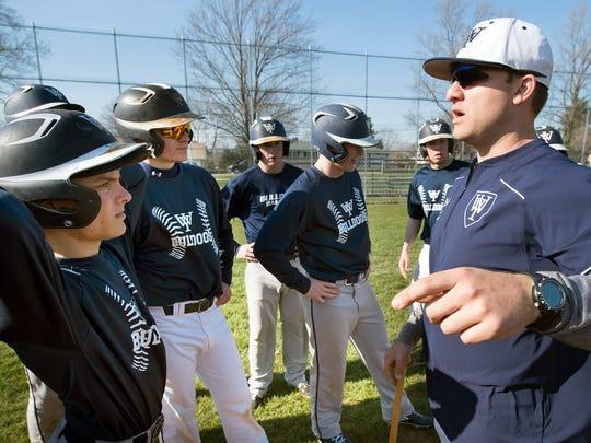 West York baseball head coach Scott Erickson, right, talks to the team during Tuesday's practice.