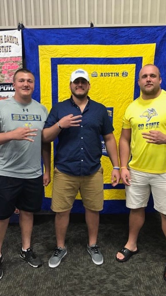 Mason McCormick (L), Austin Boen and Grant Schmidt are all headed to South Dakota State to play football.