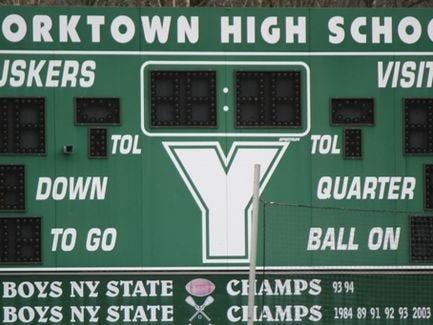 The scoreboard at Charlie Murphy Field at Yorktown High School.