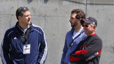 Jake Golic, with his father Mike (left) and UC coach Tommy Tuberville at the Bearcats' spring game April 5.