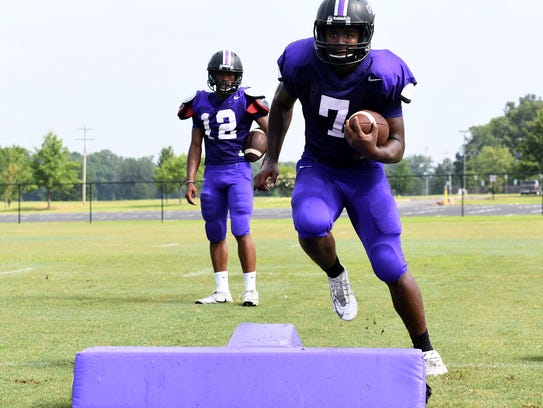Trinity Christian's Ronald Edwards watches as his teammate