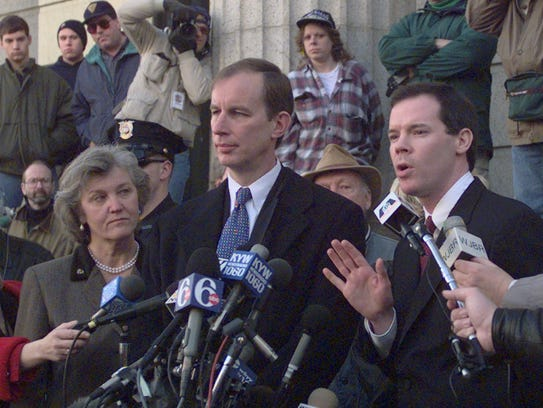 Assistant U.S. Attorney Colm Connolly, right, answers