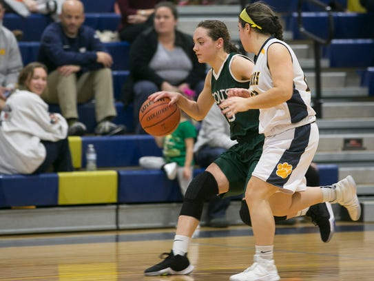 Kinnelon sophomore Taylor Smith brings up the ball