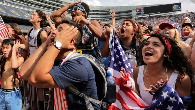 Fans cheer for the U.S. during the Brazil 2014 World Cup viewing party at Soldier Field on Tuesday, July 1, 2014 in Chicago. Belgium defeated the U.S. 2-1.