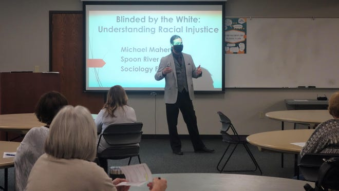 Pictured is SRC Sociology Professor Michael Maher.