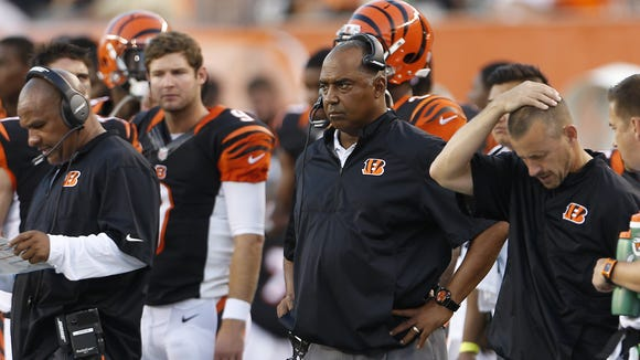 Cincinnati Bengals head coach Marvin Lewis keeps an eye on his team during their preseason game against the Indianapolis Colts at Paul Brown Stadium.