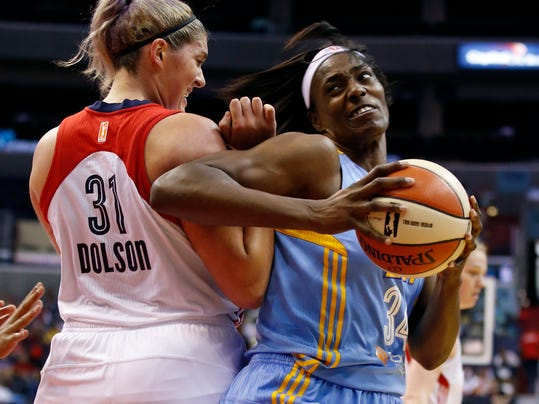 Chicago Sky center Sylvia Fowles (34) works to get past Washington Mystics center Stefanie Dolson (31) during the first half of a WNBA basketball game Wednesday, Aug. 13, 2014 in Washington.  (AP Photo/Alex Brandon)