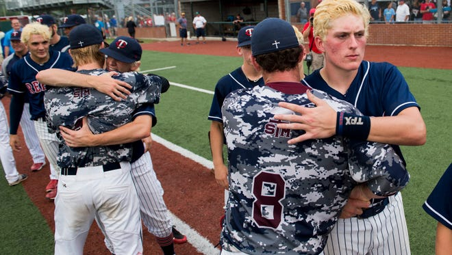 STM and Teurlings Catholic baseball players shake hands following their matchup in the LHSAA Class 4A state championship at the Horse Farm in Lafayette, La., Saturday, May 16, 2015. STM defeated Teurlings 5-1 to win the state title.