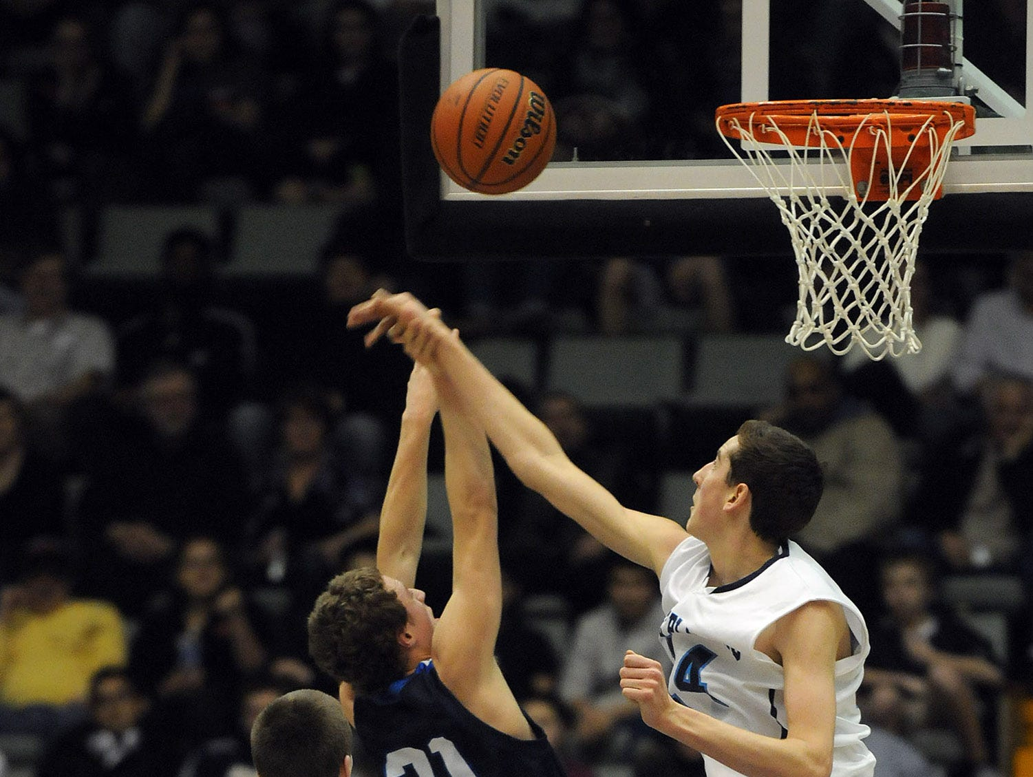 Pine Plains' Tyler Lydon blocks a shot by Lake George's Connor McCoy during the Class C state championship game on March 16, 2013 in Glens Falls.