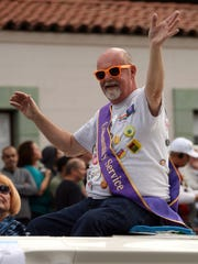 Community Service Award recipient George Zander rides on the back of a convertible on Sunday, November 6, 2011 during the Greater Palm Springs Pride 2011 Pride Parade in Palm Springs, Calif.
